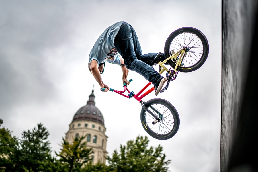 Lee Greaves, of the NoWear BMX Team, launches off the quarterpipe in front of the Capitol dome at Great Topeka Bike Fest on Sunday, September 30th. Photo by Josiah Engstrom, MotoVike Films.